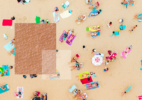 Aerial view of beach with sunbathers with close up of skin texture